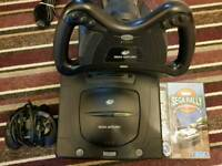 Sega Saturn console with official steering wheel and game