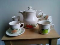 Fruit pattern coffee or tea pot with four cups and saucers and a milk jug.