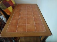 Solid tile topped table and four chairs