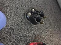 Black and red pair of doc martens infant