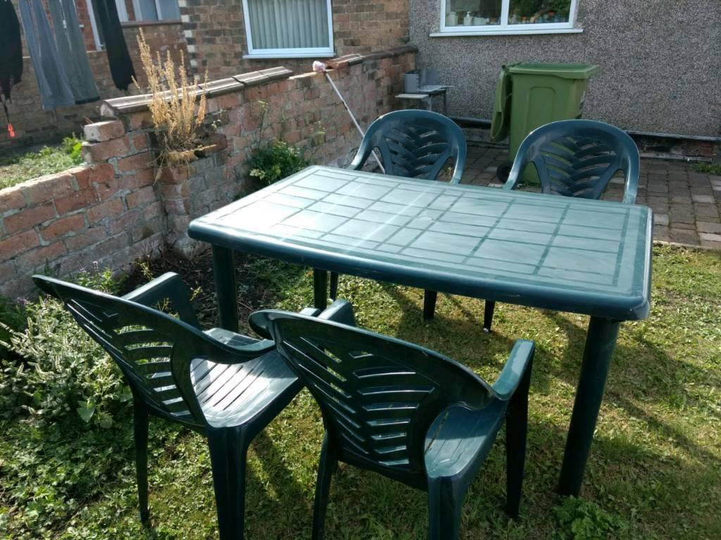 Plastic garden table and chairs grimsby