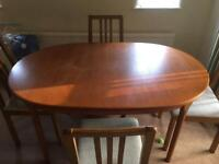 Wooden extendable dining table with chairs