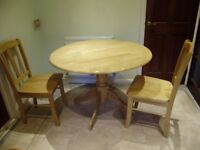 Table, drop leaf table and two chairs, solid light oak hardwood, excellent condition