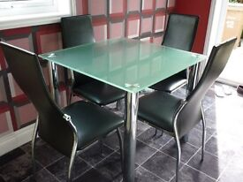Smoked Glass Dining Table and four chairs