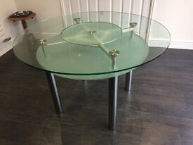 Glass Dining Table with shelf underneath, seats 4 people with turning table in the middle