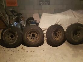 4 all terrian wheels with tyres. Offers.