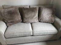 3 taupe faux fur cushions and 1 striped brown cushion