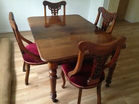 Victorian mahogany inset table and set of four carved mahogany chairs