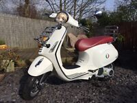 Vespa Scooter 125 (270 miles on the clock as new must see )
