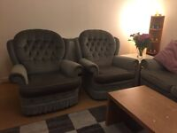 Gray three setter sofa with two arm chair
