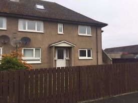 2 bedroom flat in Lossiemouth with garden front and rear and off street parking.