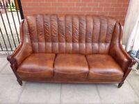 A Brown Leather Italian Three Seater Sofa