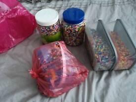 Alot of hama beads. Kids toys.
