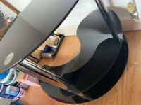 Curved black smoked glass desk
