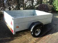 A large Caddy galvanised Car trailer