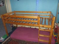 Child's single raised bed frame, wood