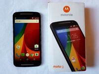 Moto G (2nd Generation) Android phone - unlocked, with black Tudia case.