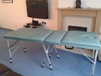 £75. Therapist Massage Couch with Cover. Portable. Nearly New. Adjustable Height and Back Rest