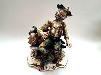 Capodimonte figure of a Tramp Sitting on a Park Bench.