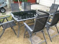 Glass top table with six chairs