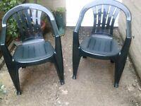2 green plastic garden chairs VGC