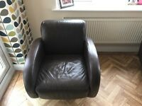 swivelling brown tub chairs