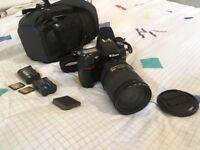 Nikon D7000 camera, zoom lens (AF-S DX NIKKOR 18-300mm f/3.5-5.6G), and Hama bag