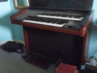 Large freestanding electric piano / keyboard / organ
