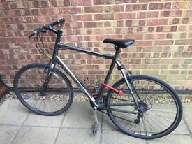 Trek Hybrid Bike with helmet, light, two bottle holders, gel seat and Squire U lock