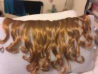 Hair extensions in golden blonde