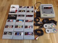 SNES super nintendo with 18 games