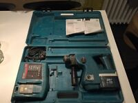 Makita 24v sds masonry drill with one battery and charger in box. In great working order.