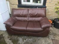 2 seater leather sofa free to good home kept outside at the moment so get it before it Rains!