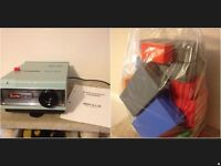 Vintage boots slide projector in very good condition. comes with big bag of slide cases,