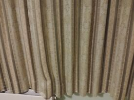 Pair of retro style green patterned curtains