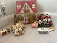 Sylvanian Families Red Roof Cosy Cottage and family saloon car, with rabbit and elephant families.