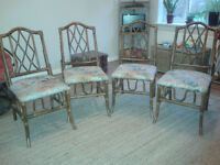 Four matching cane bamboo chairs for sale.