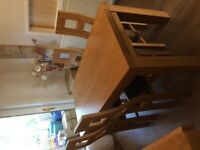 Oakfurniture land dining table and four chairs