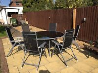 Large round glass table & 6 high back reclining chairs