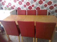 extending Table and six red chairs