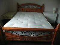 solid wooden kingsize bed