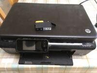 HP Photosmart 5524 printer with extra black cartridge