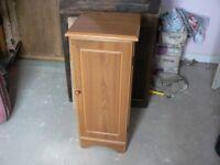 Tall upright small storage cupboard,ideal cd's etc