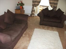 3 and 2 seater sofa + Pouffee in brown material - good condition £75.00 - collection only