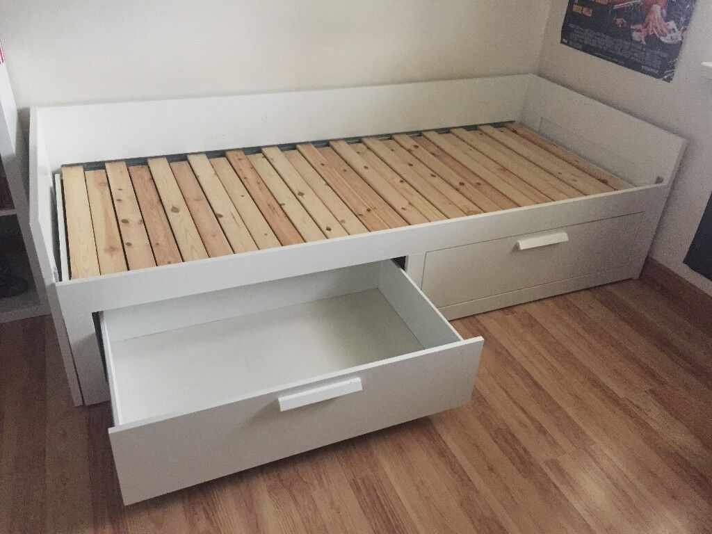 Ikea white day-bed with 2 drawers and 2 mattresses. Excellent condition.
