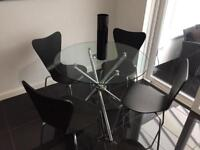 As new modern dining table and chairs