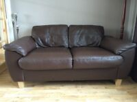 2 chocolate brown 2 seater leather sofas.