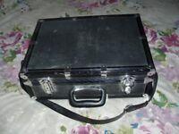 black metal camera carrying case