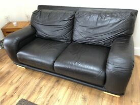 Chocolate leather sofa. 3 seater, 2 seater, armchair and puffy.