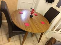 Drop leave Dining Table and 2 chairs available in excellent condition